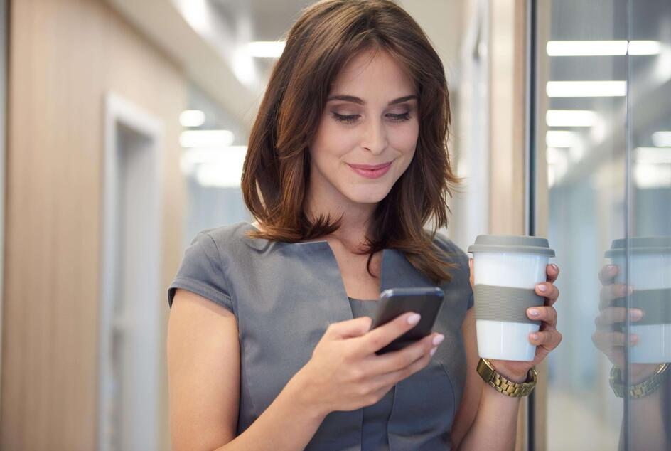 close-up-woman-drinking-coffee-operating-phone-min (1)